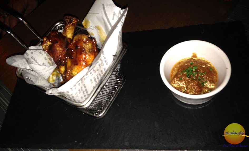 Honey glazed chicken wings with sauce at Salt Burgers barcelona