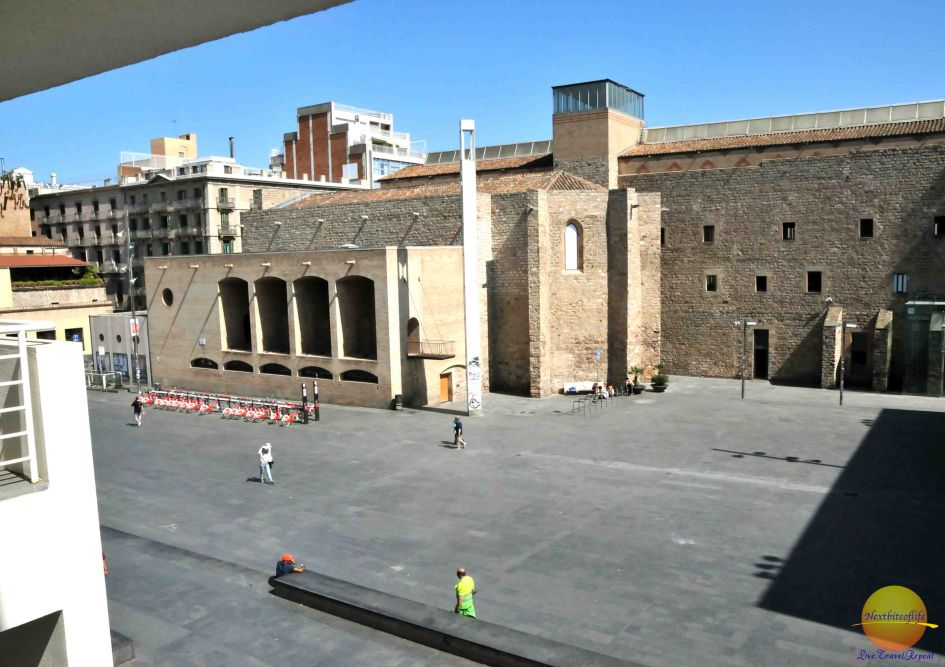 The plaza de Angels outside of the museum, a popular spot for skate boarding. You can see part of the ancient wall of the old city in the background.