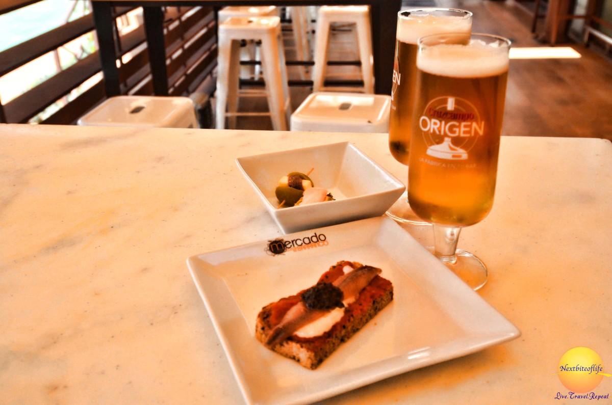 tapas and beer at mercado barranco seville