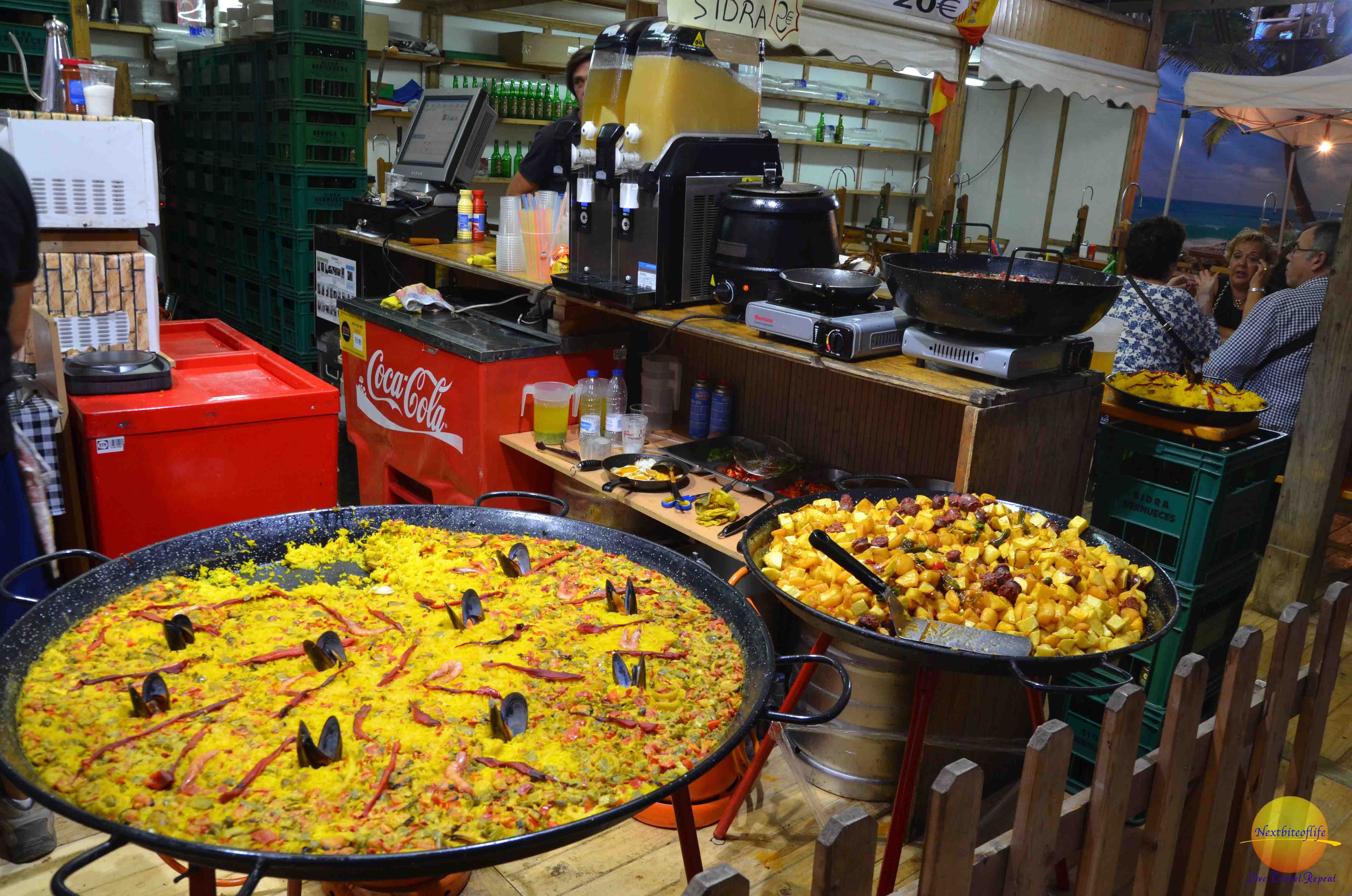 Those potatoes looked awesome! The paella doesn't look half bad either!