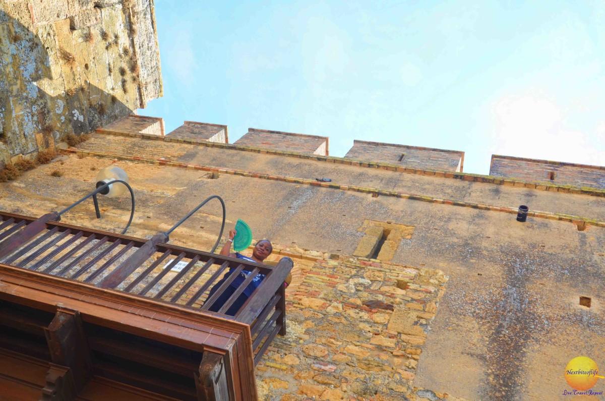 carmona fortress lady holding fan