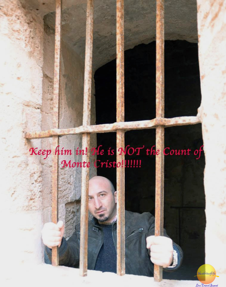"man ""behind bars"" at chateau d'if marseille"