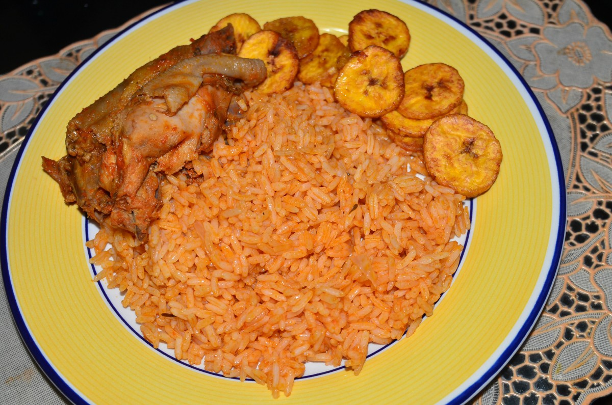 If l had to pick my ultimate favorite meal, like last meal on earth kind of thing. It would be simple jollof rice, plenty of plantain..and goat or chicken, or beef.. Jollof rice can be different colors as people experiment with additions, including little pieces of liver, peas, carrots etc...but l like simple. The original and the best :-) .
