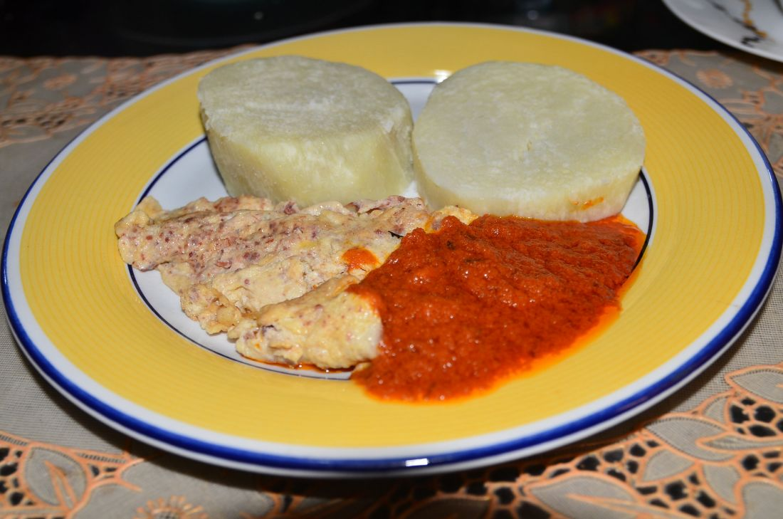 A Sunday favorite of many Nigerians for breakfast. Boiled yam with fried eggs and stew. We eat everything with stew it seems. Stew and goat meat.