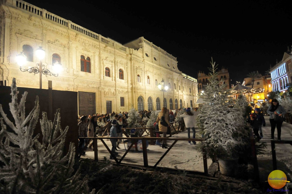 Kids and adults alike at the makeshift ice rink in seville spain.