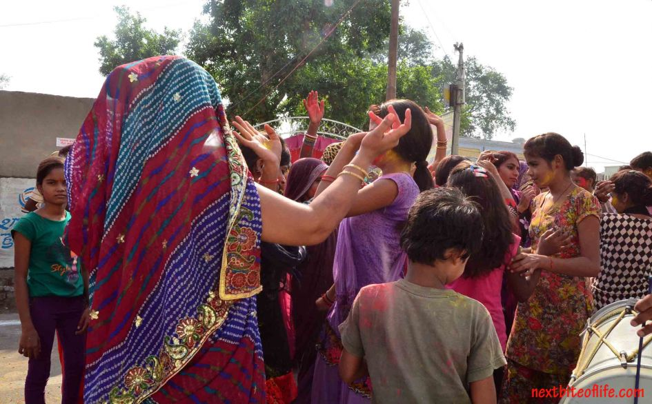Young girls doing an impromptu dance in the streets of Delhi.