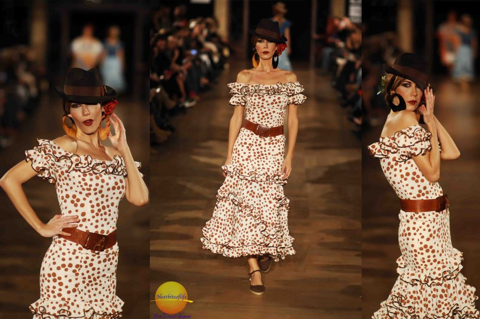 flamenco runway model in mid length brown spotted dress off shoulder