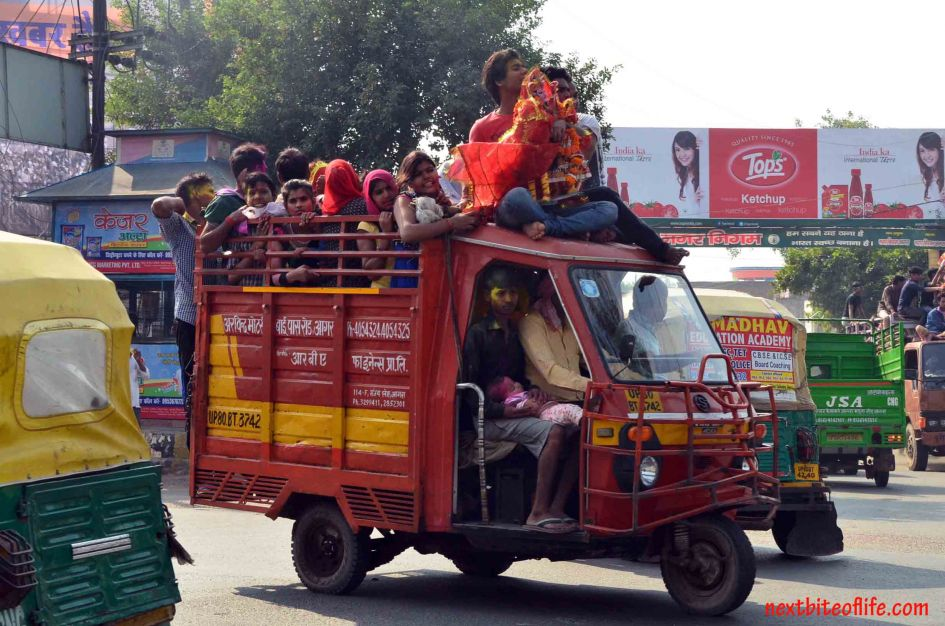 hindus squeezed into a little truck at festival