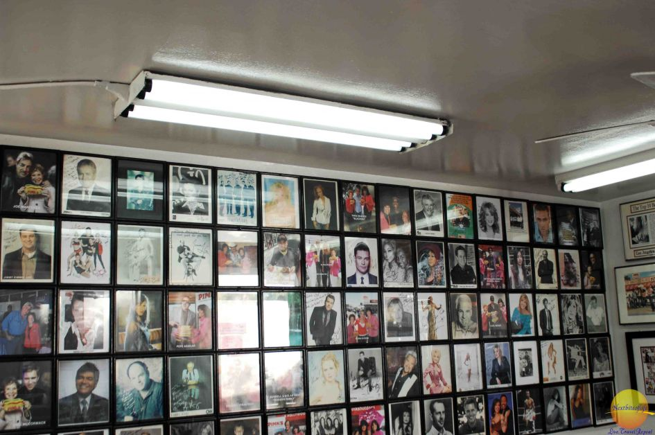 framed pictures of stars on the wall at pinks hot dogs los angeles