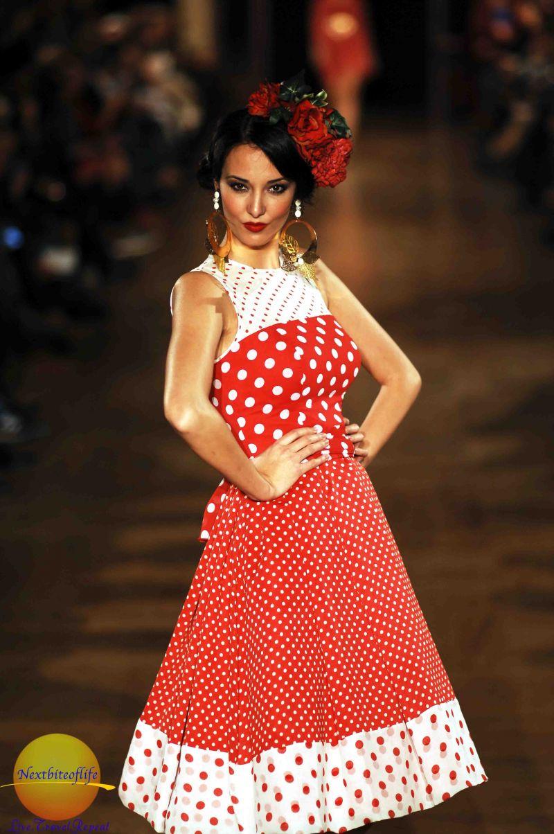 red shorter length flamenco dress on runway model