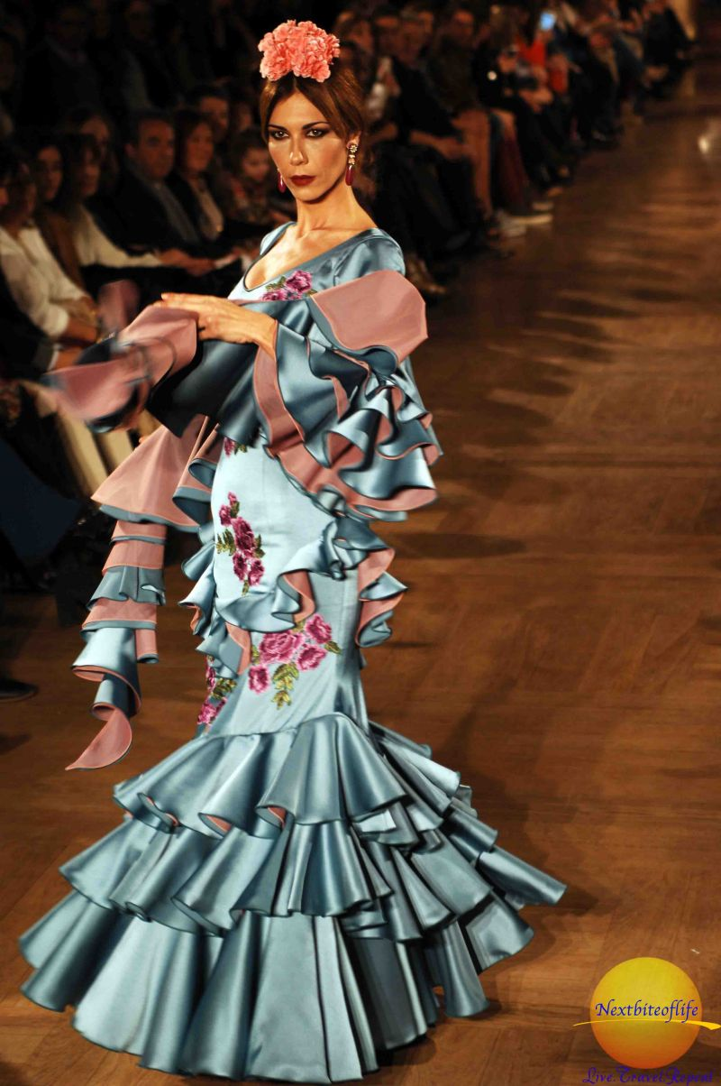 Bluish colors of flamenco outfit on runway model
