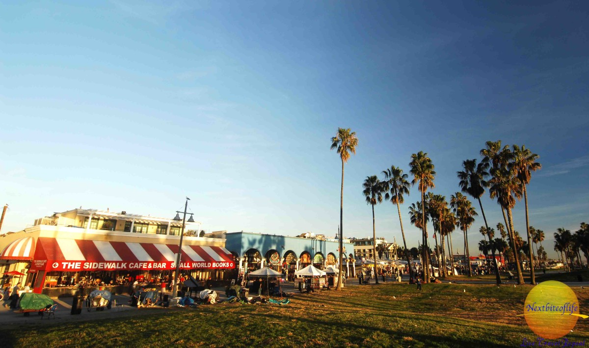 venice boardwalk view with cafe and people