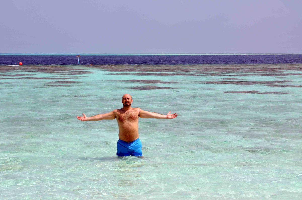 man with arms outstretched in the sea