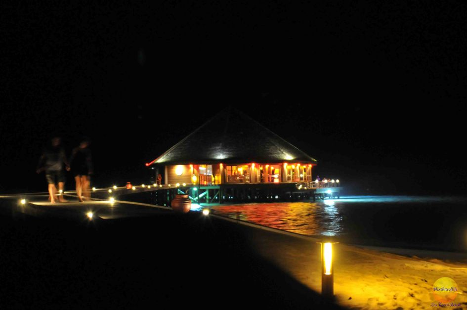view of over water restaurant at night in Vilamendhoo