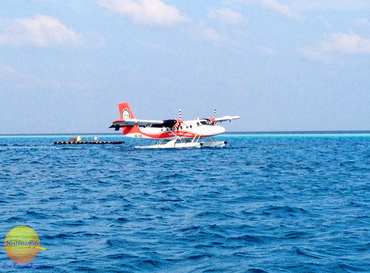 seaplane landing in the Maldives, Vilamendhoo in the sea with raft