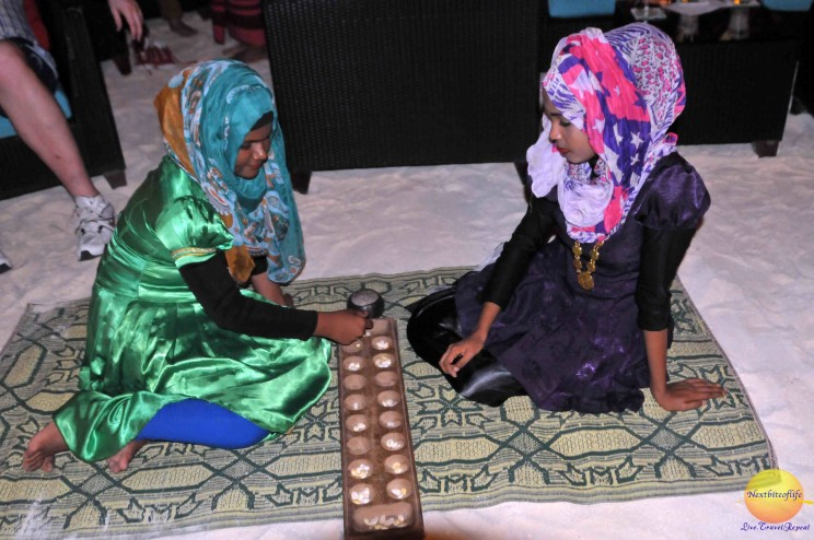"Cultural night..women playing what we call ""Ayo"" in Nigeria."