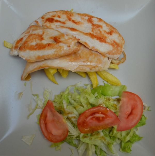 chicken breast plate with fries and salad