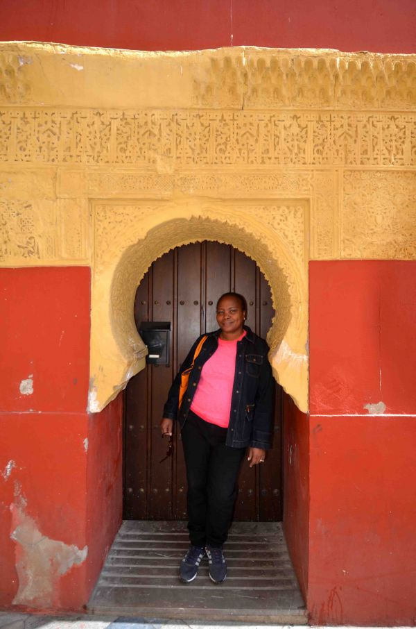 Taking it all in stride in doorway Cordoba.. our epic travel fail to visit Mallorca