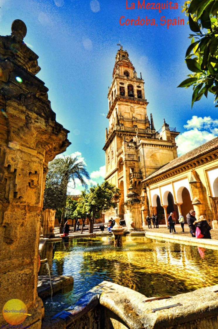 mezquita courtyard with minaret and fountain #mezquita #cordoba #cordobamosque