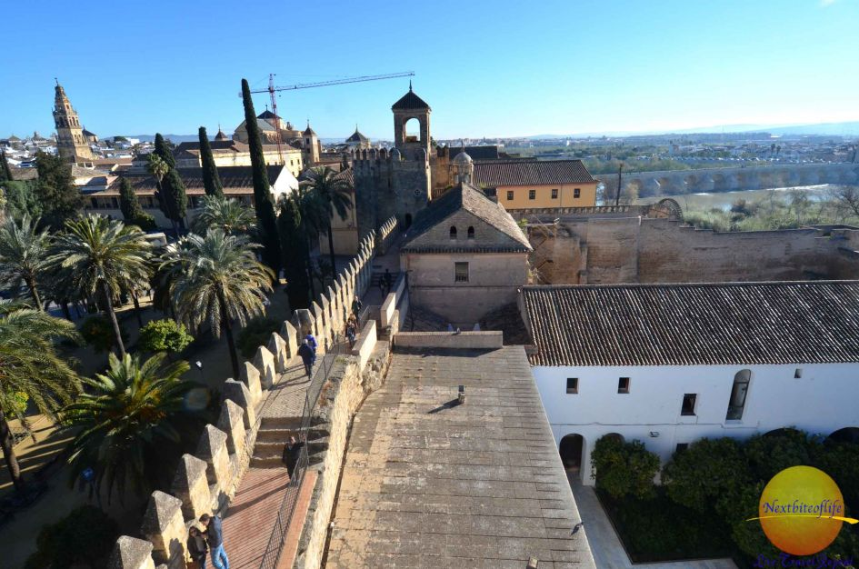 alcazar cordoba rooftop with wall and people walking