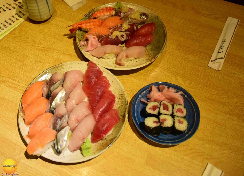 what to eat in japan definitely includes sushi like on these 3 plate assortment of rolls