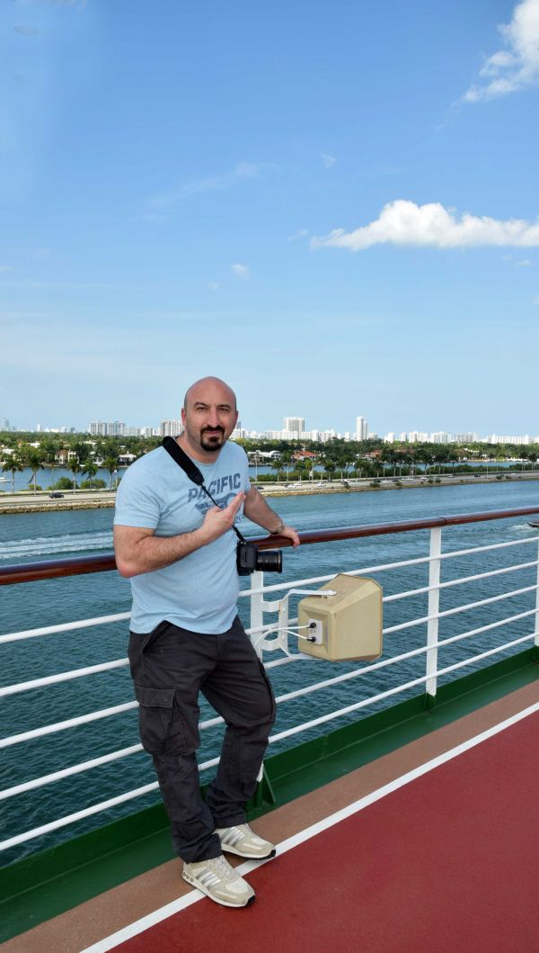 man posing on cruise ship against Florida landscape