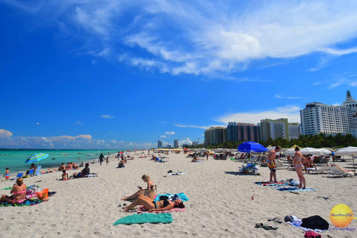 Miami beach with people and buildings