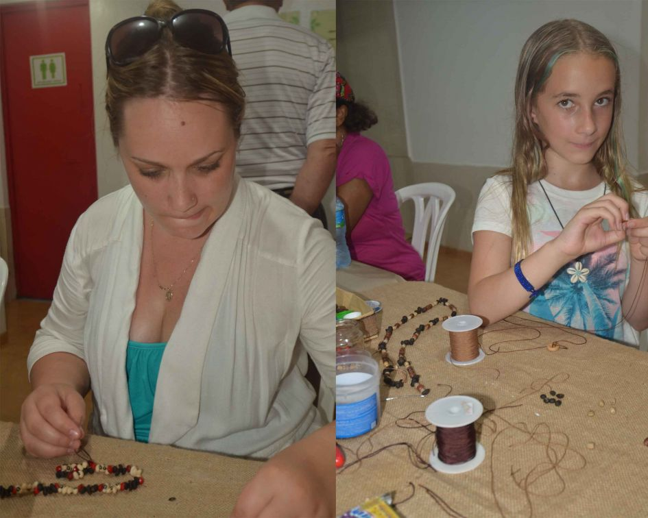 Everyone wa put to work. A mother and daughter team helping to make jewelry.