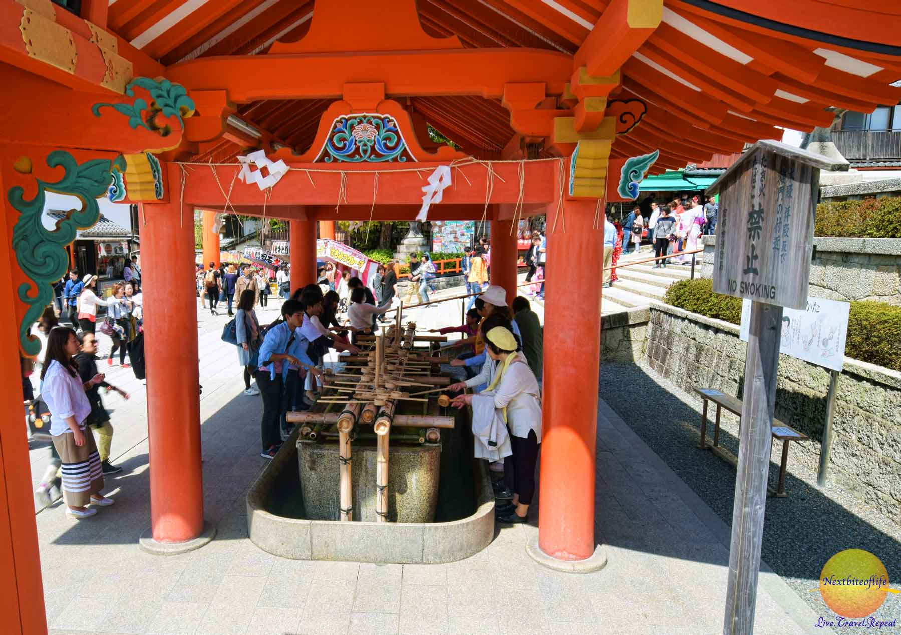 People doing the cleansing ritual prior to entering the shrine. It is not compulsory.
