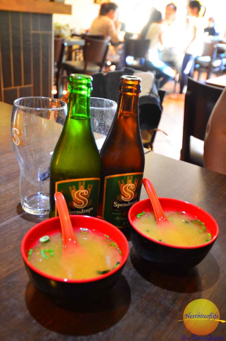 Miso soup and beer at a restaurant in Stockholm.