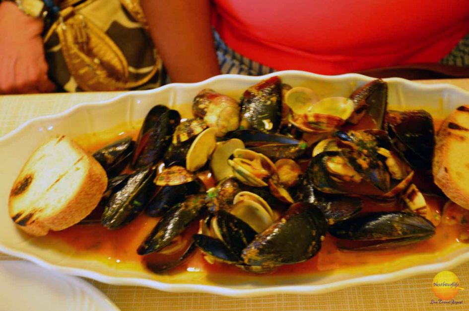 Seafood marinara sauce and mussels plate Bologna City Guide