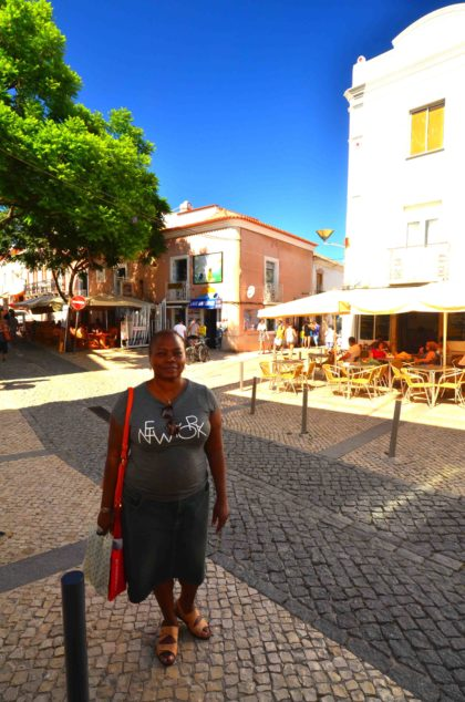 woman posing in cork shoes, lagos portugal