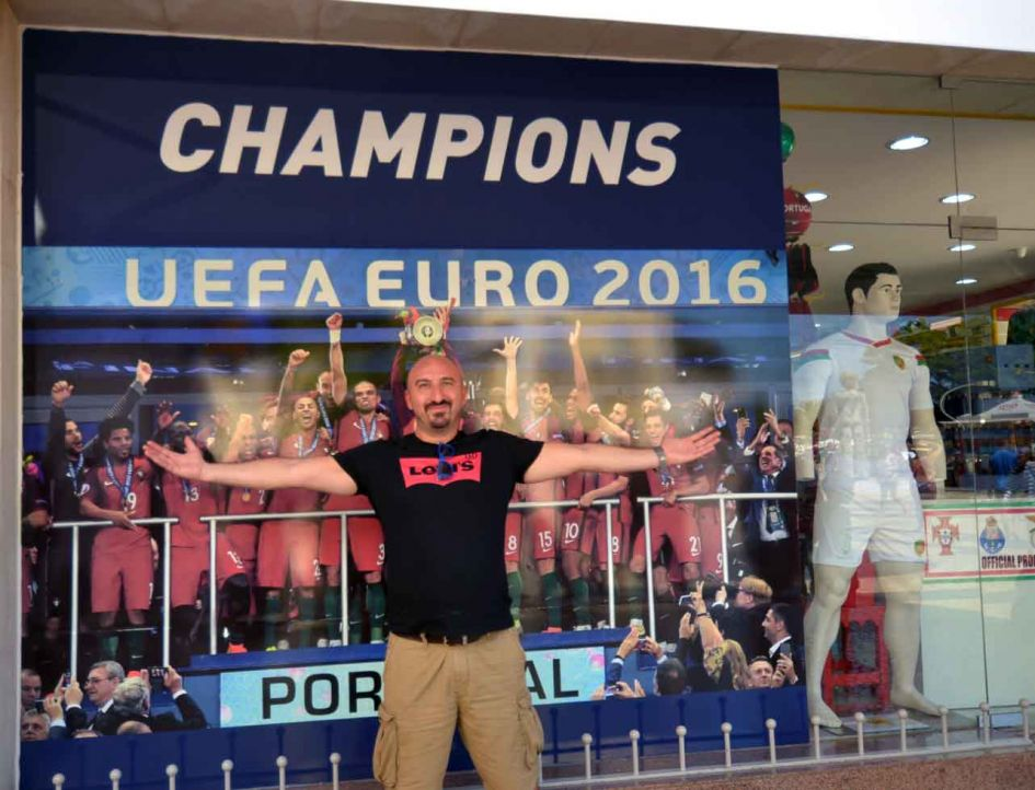 man in front of soccer shop lagos ortugal