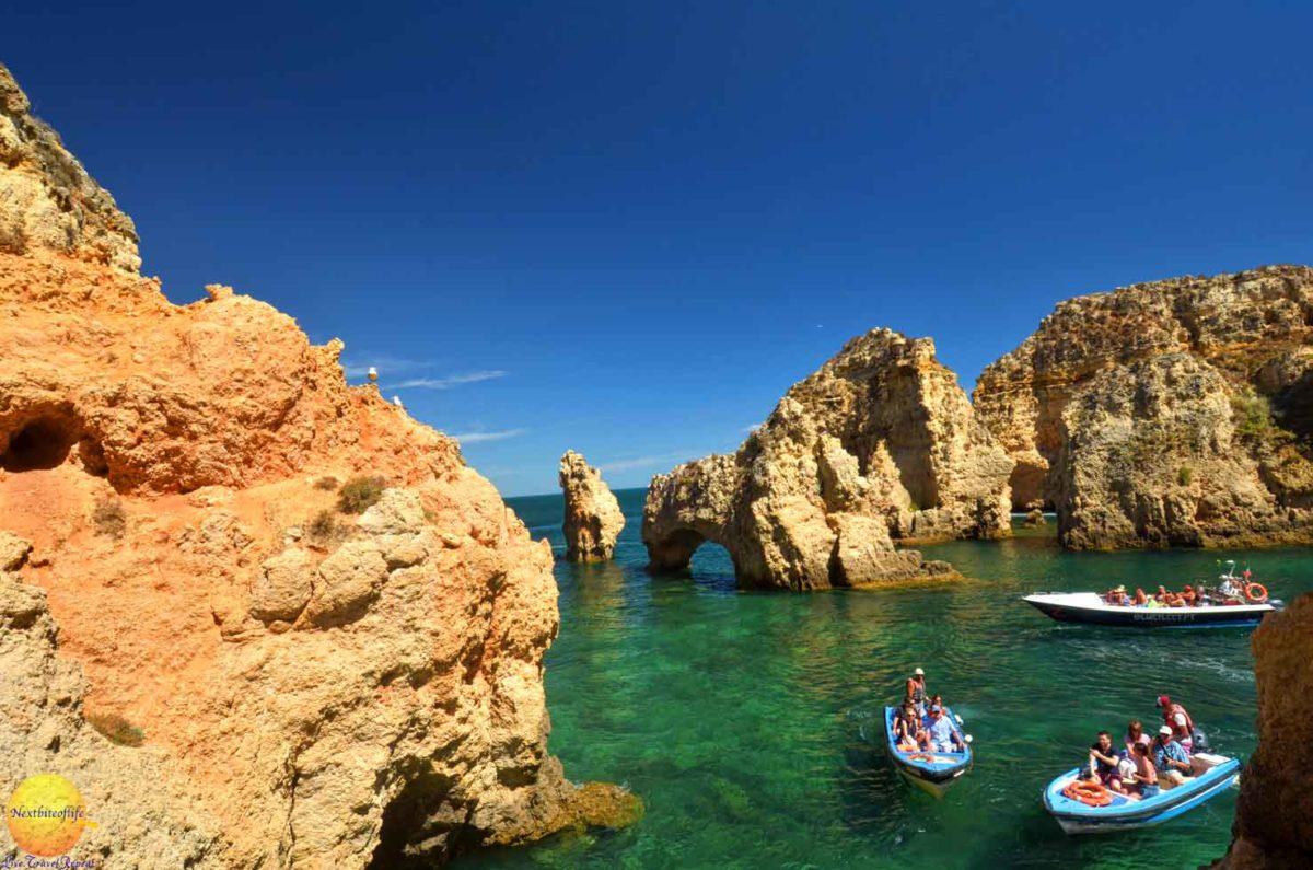 boaters at ponta de piedade portugal