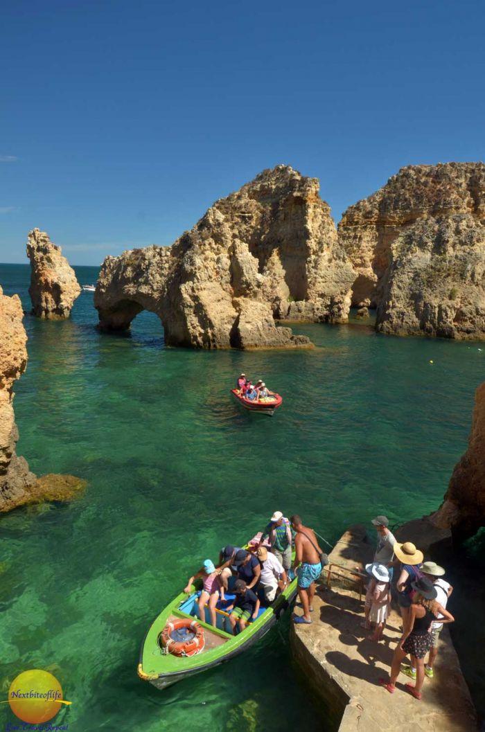 ponta de piedade boat rides with people getting into the boats #pontadepiedad #algarve #lagoportugal #lagospontadepiedade #portugal #lagosportugal