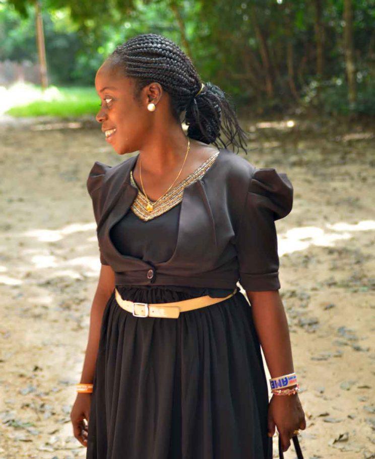 Osun Oshogbo sacred grove guide in black dressguide