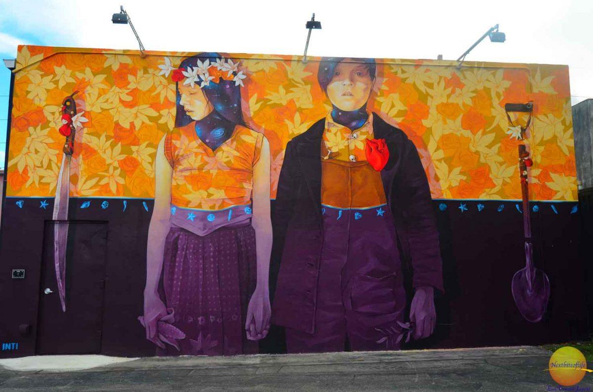 couple mural girl looking away wynwood