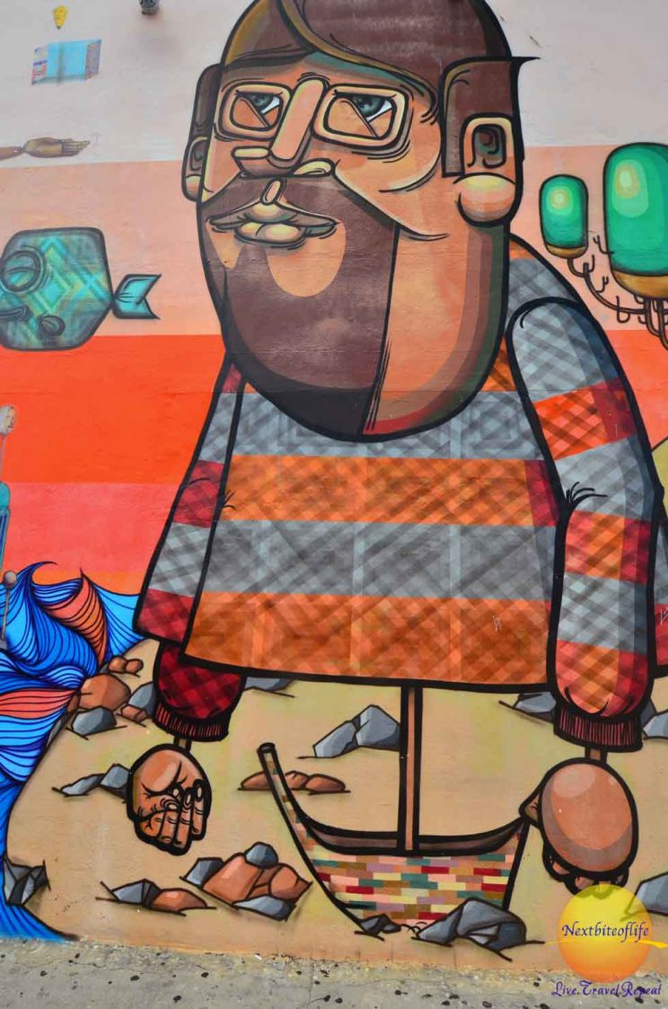 mural of boy with glasses wynwood