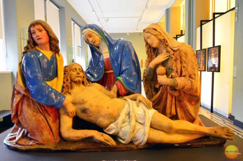 fallen Jesus and 3 women comforting him
