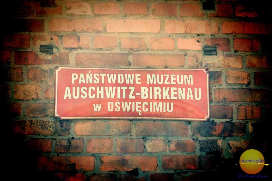 should l visit Auschwitz post sign at cell block