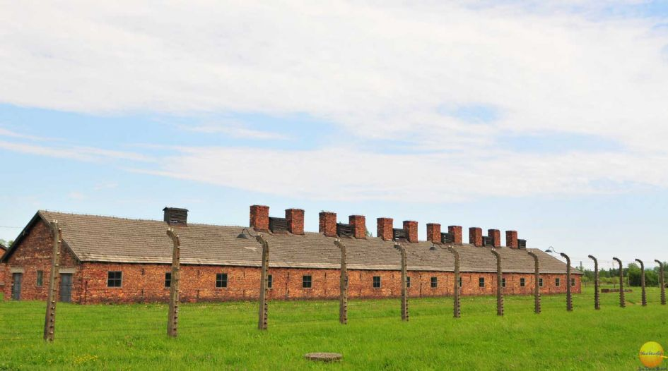 Birkenau prisoners living quarters and fence around it