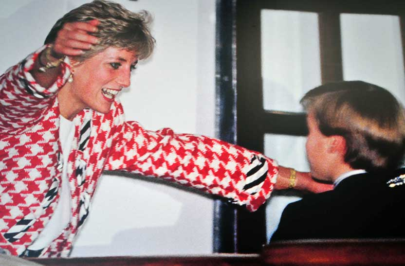 poster of Princess Diana going in for an embrace of Prince William