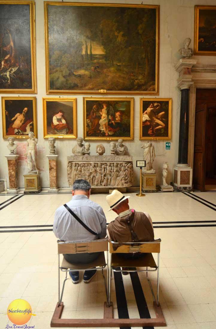 2 men sleeping in front of caravaggio