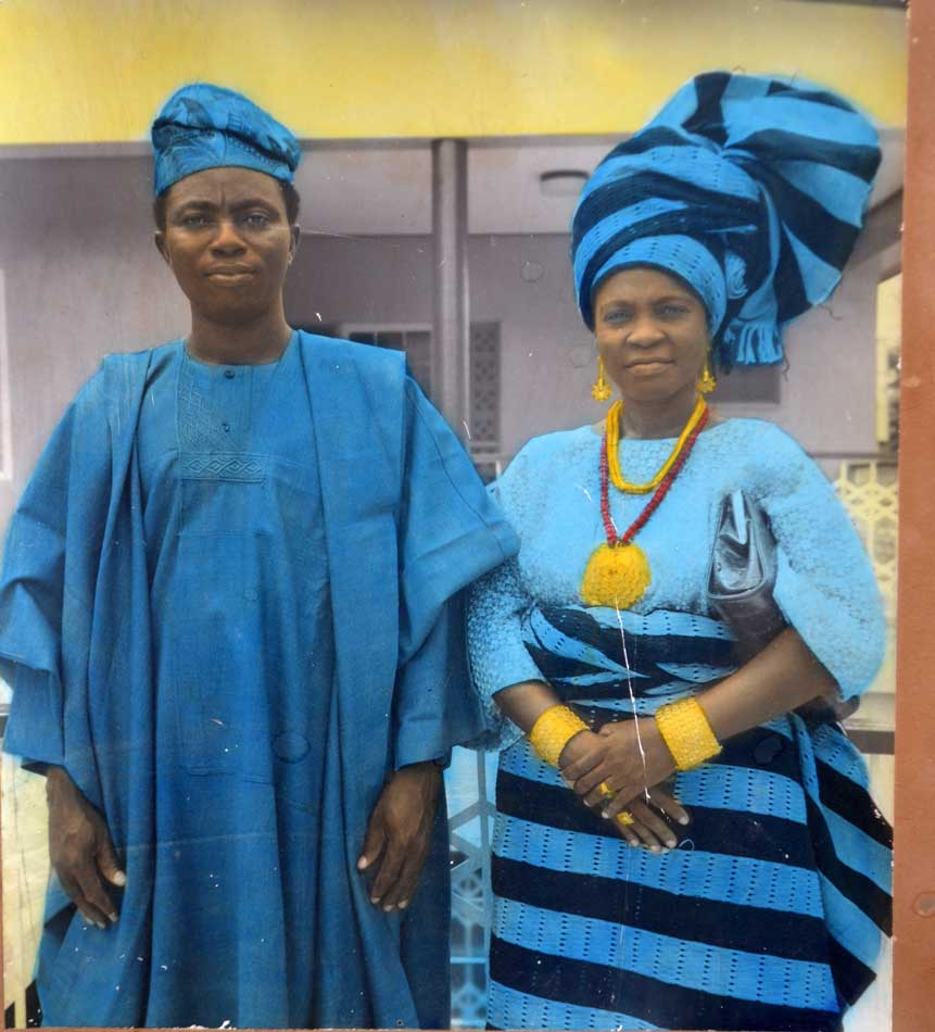 Nigerian couple in native costumes blue and gold