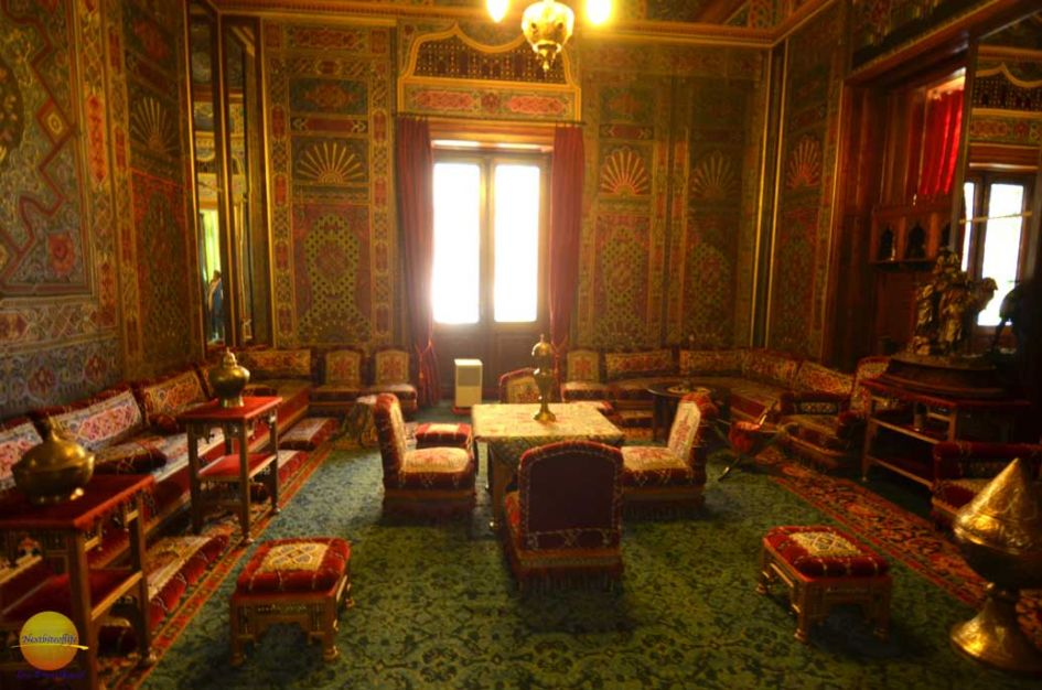Arabic room in interior with arabesque chairs and wallpapered walls