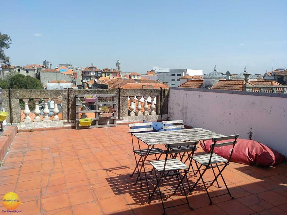 terrace in porto portugal with table and chairs