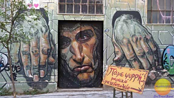 Good bad and ugly sides of Athens guide with street art mural of man in jail looking out