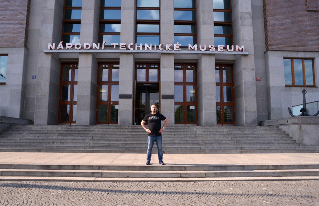 man in front of prague technicke museum