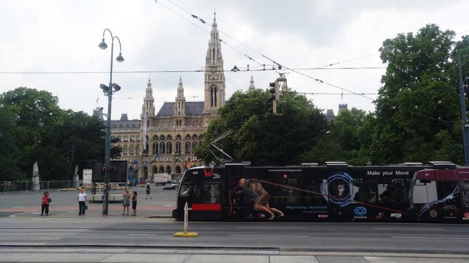 Vienna city hall with black tram passing by