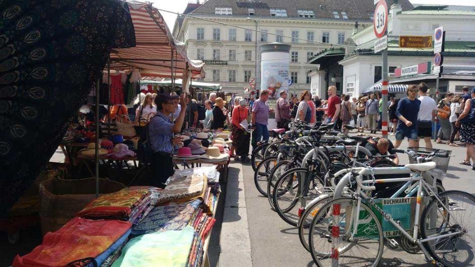 naschmarkt flea market vienna - bikes and clothing racks in our week in Vienna guide
